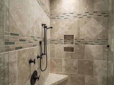 custom tile shower and oil rubbed bronze plumbing fixtures